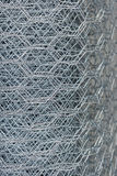 Chicken wire mesh. Roll of steel mesh chicken wire royalty free stock photos