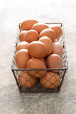 Chicken Wire Tray Filled with Brown Eggs. Chicken wire tray filled with brown chicken eggs royalty free stock image