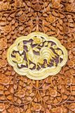 Chicken wood Carving Wall sculptures in thai temple Royalty Free Stock Photo