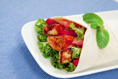 Chicken wrap. Healthy chicken tortilla wrap with lettuce, tomatoes, capsicum and  peri peri sauce Royalty Free Stock Photography
