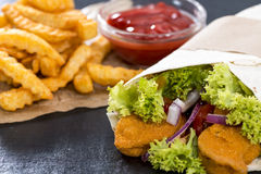 Chicken Wrap. (close-up shot) with crispy fried chicken and chips Stock Image