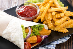 Chicken Wrap. (close-up shot) with crispy fried chicken and chips Royalty Free Stock Photography