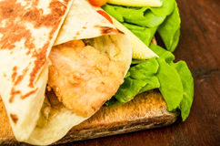 Chicken wrap. Close up on wood Royalty Free Stock Images