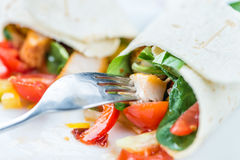Chicken Wrap. (detailed close-up shot; selective focus) on wooden background Stock Photo