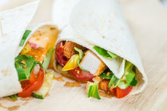 Chicken Wrap. (detailed close-up shot; selective focus) on wooden background Stock Images