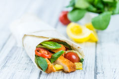 Chicken Wrap. (detailed close-up shot; selective focus) on wooden background Royalty Free Stock Image