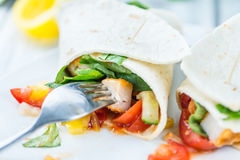 Chicken Wrap. (detailed close-up shot; selective focus) on wooden background Stock Image