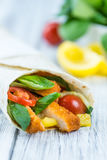 Chicken Wrap. Detailed close-up shot; selective focus on wooden background Royalty Free Stock Images