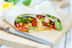 Chicken Wrap. Detailed close-up shot; selective focus on wooden background Royalty Free Stock Photography