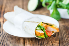 Chicken Wrap. Detailed close-up shot; selective focus on wooden background Stock Photos