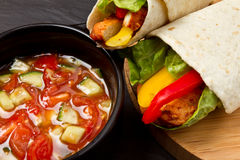 Chicken wrap n salsa. Spicy chicken wrap and pot of vibrant salsa Stock Photo