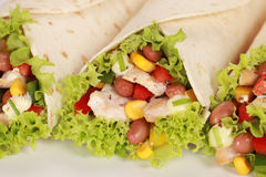 Chicken Wrap Sandwich. Filled with beans, lettuce and corn stock images