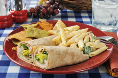 Chicken wrap sandwiches with pasta salad Stock Photo