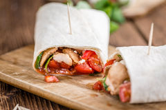 Chicken Wrap (selective focus). Chicken Wrap (close-up shot; selective focus) on vintage wooden background Stock Image
