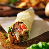 Chicken wrap with in tortilla Stock Image