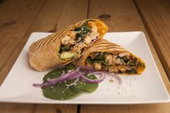 Chicken wrap on a wooden table stock photography