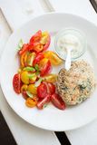 Chickenburger with tomato salad Royalty Free Stock Photography