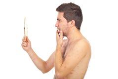 chickenpox смотря зеркало человека Стоковая Фотография RF