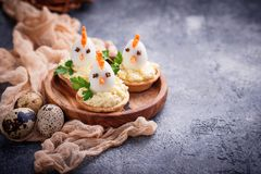 Chickens from eggs. Easter appetizers for party. Selective focus stock images