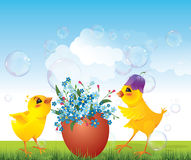 Chickens and floral egg on meadow Stock Photos