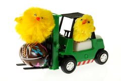 Chickens on a forklift with Easter egg. 2 chickens on a toy forklift with Easter egg Stock Photo