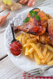 Chickens with French fries Stock Photography