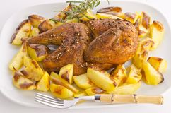 Chickens roast with baking potatoes Stock Image