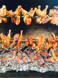 Chickens are roasted on a grill with wood Royalty Free Stock Image