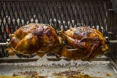 Chickens on the spit. Grilled chickens on the spit stock image