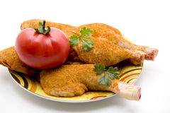 Chickens thighs with tomato Stock Photography