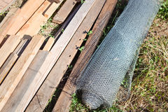 Chickenwire Roll and Lumber Stock Photography