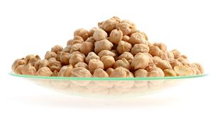 Chickpea. On a watch glass. , a legume with protein rich seeds, is one of the oldest cultivated vegetables Royalty Free Stock Photos