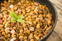 Chickpea and bacon stew Stock Image