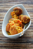 Chickpea balls with sauce Stock Images