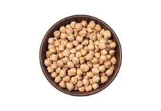 Dried White chickpeas, White Chana, Dried Chickpea Lentils, Pakistani/Indian beans in wooden bowl isolated on white Background. The chickpea or chick pea Cicer royalty free stock photography