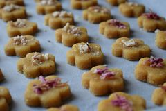 Chickpea cookies pastries with almonds and tea rose petals. Traditional Eastern sweets. Gluten free. Grain free. Paleo diet. Healthy food stock images