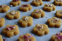 Chickpea cookies pastries with almonds and tea rose petals. Traditional Eastern sweets. Gluten free. Grain free. Paleo diet. Healthy food royalty free stock image