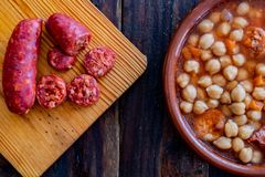 Chickpea dish on wooden background stock photography