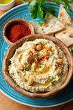 Chickpea hummus with paprika and pita chips. Homemade hummus. Healthy vegan chickpea spread in bowl. Closeup view, selective focus royalty free stock images