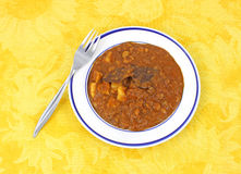 Chickpea masala on yellow cloth with fork Stock Photos