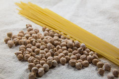 Chickpea and pasta. On a white bag Royalty Free Stock Photos