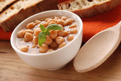 Chickpea soup. In white bowl on wooden table Stock Photos