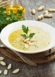 Chickpea soup with peanuts and herbs Stock Photos