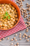 Chickpea soup in terracotta bowl. Stock Photography