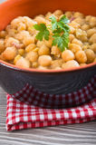 Chickpea soup in terracotta bowl. Royalty Free Stock Photography