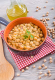 Chickpea soup in terracotta bowl. Stock Photos