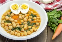 Chickpea stew with spinach Stock Photos