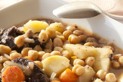 Chickpea stews. Chickpea stew with black pudding and potato Stock Image