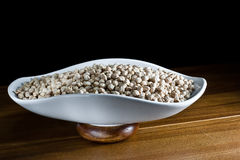 Chickpea in tray table on wood Royalty Free Stock Photo
