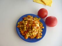 Chickpea vegetable salad on a blue plate Stock Image